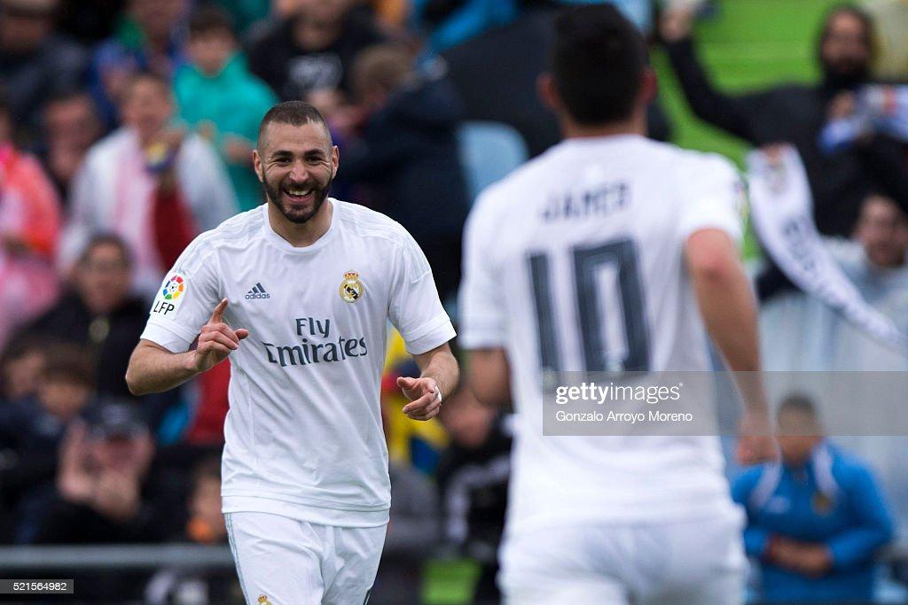 Karim Benzema of Real Madrid CF celebrates scoring their opening goal with teammate James Rodriguez during the La Liga match between Getafe CF and...