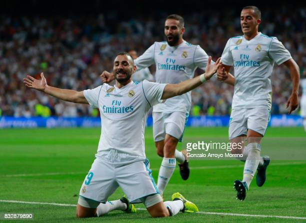Karim Benzema of Real Madrid CF celebrates scoring their second goal with teammate Lucas Vazquez and Daniel Carvajal during the Supercopa de Espana...