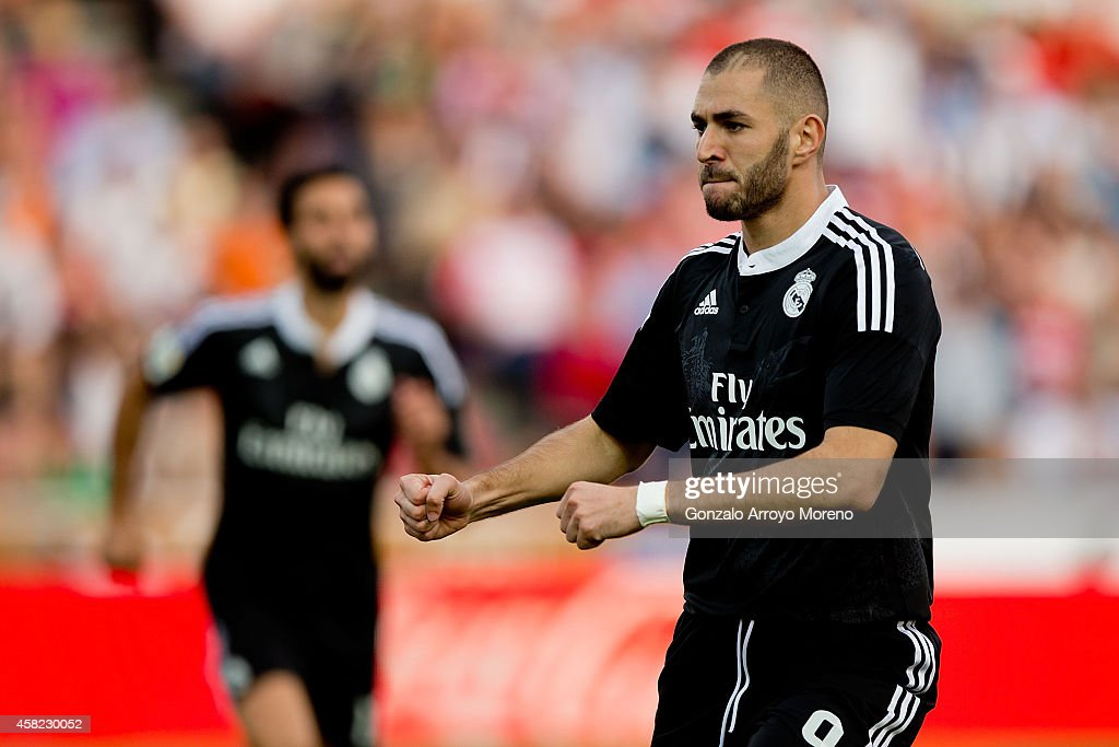 Karim Benzema of Real Madrid CF celebrates scoring their third goal during the La Liga match between Granada CF and Real Madrid CF at Nuevo Estadio...