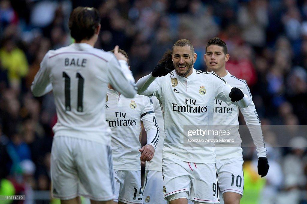 Karim Benzema (2nd R) of Real Madrid CF celebrates scoring their third goal with team-mate Gareth Bale (L) during the La Liga match between Real Madrid CF and Real Sociedad de Futbol at Estadio Santiago Bernabeu on January 31, 2015 in Madrid, Spain.