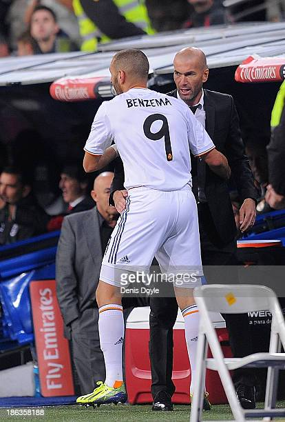 Karim Benzema of Real Madrid CF celebrates with assistant coach and former Real player Zinedine Zidane after scoring Real's 4th goal during the La...