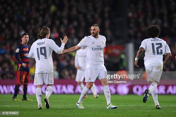 Karim Benzema of Real Madrid CF celebrates with teammate Luka Modric after scoring his team's first goal during the La Liga match between FC...