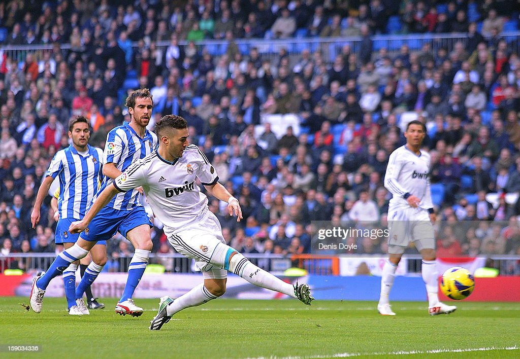 Karim Benzema of Real Madrid CF scores his team's opening goal during the La Liga match between Real Madrid CF and Real Sociedad de Futbol at estadio Santiago Bernabeu on January 6, 2013 in Madrid, Spain.