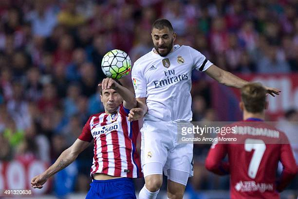 Karim Benzema of Real Madrid CF wins the header after Gabi Fernandez of Atletico de Madrid during the La Liga match between Club Atletico de Madrid...