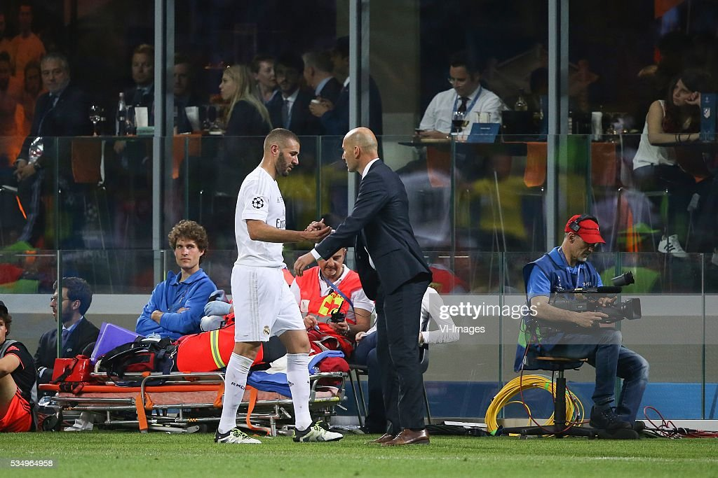 Karim Benzema of Real Madrid, coach Zinedine Zidane of Real Madrid during the UEFA Champions League final match between Real Madrid and Atletico Madrid on May 28, 2016 at the Giuseppe Meazza San Siro stadium in Milan, Italy.