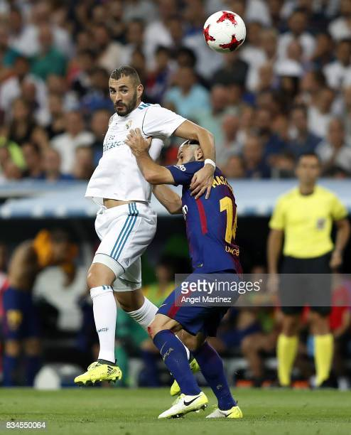 Karim Benzema of Real Madrid competes for the ball with Javier Mascherano of FC Barcelona during the Supercopa de Espana Final second leg match...