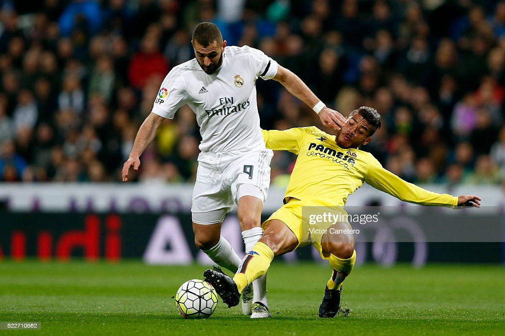 Karim Benzema of Real Madrid competes for the ball with Jonathan dos Santos of Villarreal during the La Liga match between Real Madrid CF and Villarreal CF at Estadio Santiago Bernabeu on April 20, 2016 in Madrid, Spain.