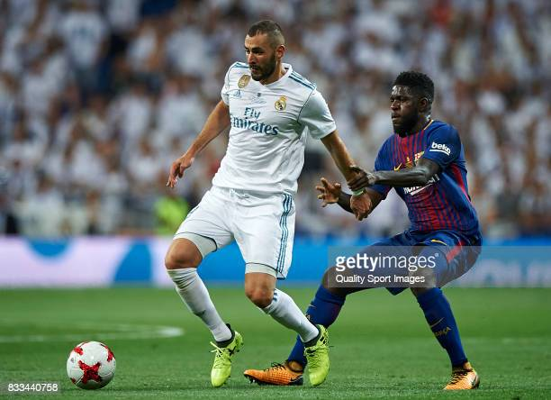 Karim Benzema of Real Madrid competes for the ball with Samuel Umtiti of Barcelona during the Supercopa de Espana Supercopa Final 2nd Leg match...