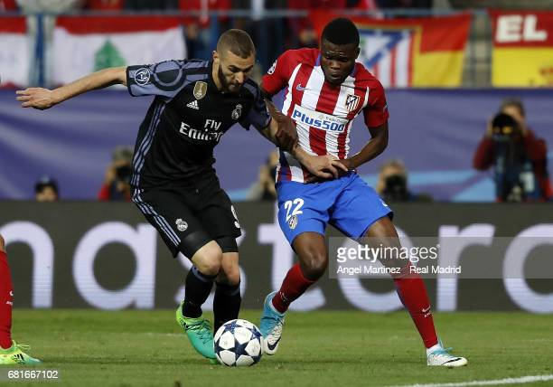 Karim Benzema of Real Madrid competes for the ball with Thomas Teye Partey of Club Atletico de Madrid during the UEFA Champions League Semi Final...