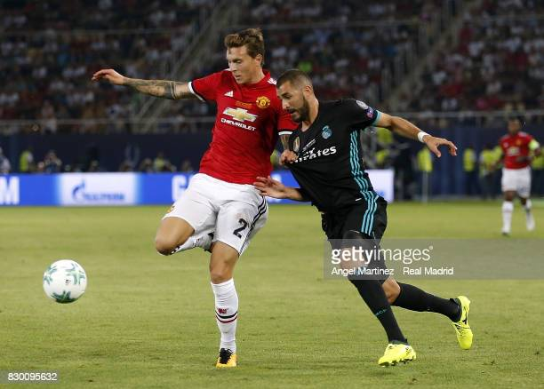 Karim Benzema of Real Madrid competes for the ball with Victor Lindelof of Manchester United during the UEFA Super Cup match between Real Madrid and...