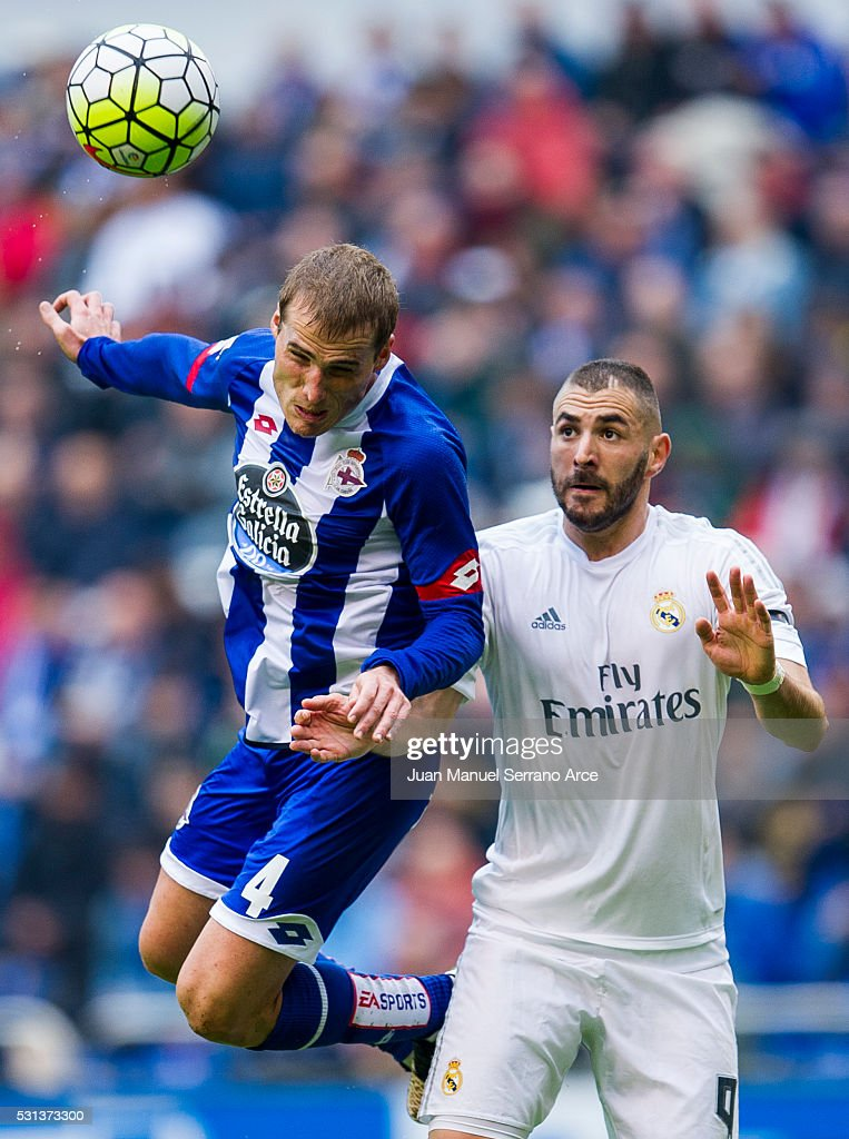 Karim Benzema of Real Madrid duels for the ball with Alex Bergantinos of RC Deportivo La Coruna during the La Liga match between RC Deportivo La Coruna and Real Madrid CF at Riazor Stadium on May 14, 2016 in La Coruna, Spain.