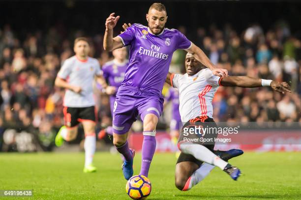 Karim Benzema of Real Madrid fights for the ball with Eliaquim Hans Mangala of Valencia CF during their La Liga match between Valencia CF and Real...