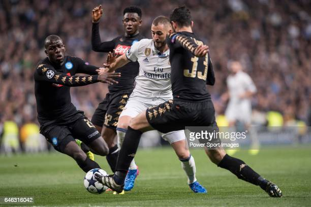 Karim Benzema of Real Madrid fights for the ball with Kalidou Koulibaly of SSC Napoli and his teamates Raul Albiol and Amadou Diawara during the...