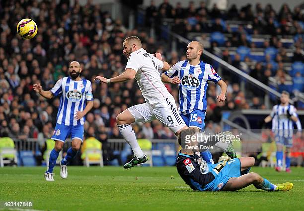 Karim Benzema of Real Madrid gets past Fabricio Agosto ''Fabri'' of RC Deportivo La Coruna during the La Liga match between Real Madrid CF and RC...