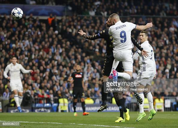 Karim Benzema of Real Madrid heads the ball to score his team's firts goal during the UEFA Champions League Round of 16 first leg match between Real...