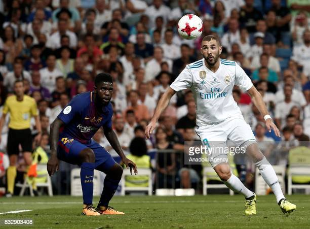 Karim Benzema of Real Madrid in action against Samuel Umtiti of Barcelona during the Spanish Super Cup return match between Real Madrid and Barcelona...
