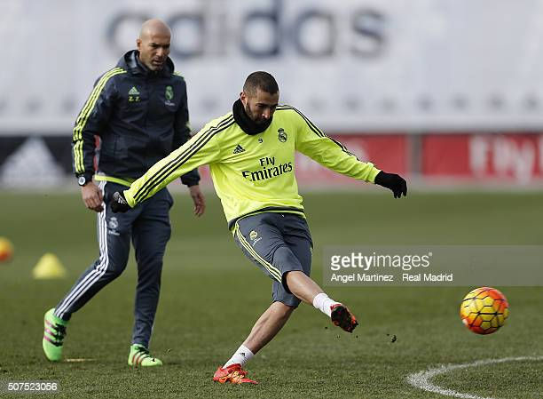 Karim Benzema of Real Madrid in action beside head coach Zinedine Zidane during a training session at Valdebebas training ground on January 30 2016...