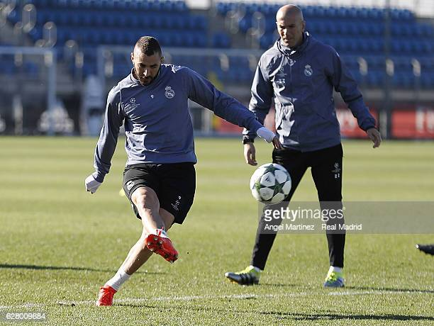 Karim Benzema of Real Madrid in action beside head coach Zinedine Zidane during a training session at Valdebebas training ground on December 6 2016...