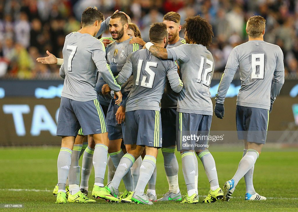 Karim Benzema of Real Madrid is congratulated by team mates after scoring a goal during the International Champions Cup match between Real Madrid and Manchester City at Melbourne Cricket Ground on July 24, 2015 in Melbourne, Australia.