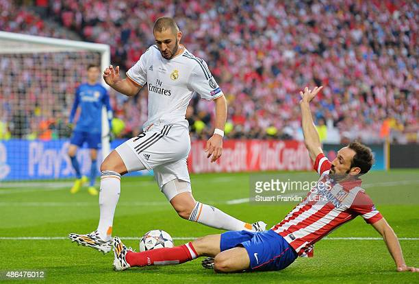 LISBON PORTUGAL MAY 24 Karim Benzema of Real Madrid is tackled by Juanfran of Club Atletico de Madrid during the UEFA Champions League Final between...