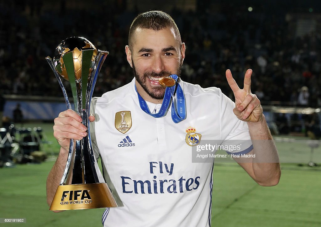 Karim Benzema of Real Madrid poses with the trophy after the FIFA Club World Cup Final match between Real Madrid and Kashima Antlers at International Stadium Yokohama on December 18, 2016 in Yokohama, Japan.