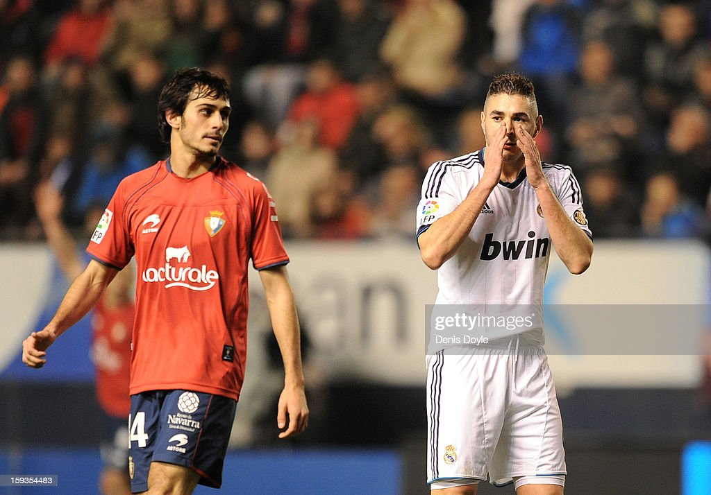 Karim Benzema (R) of Real Madrid reacts beside Alejandro Arribas of Osasuna during the La Liga match between Osasuna and Real Madrid at estadio Reino de Navarra on January 12, 2013 in Pamplona, Spain.