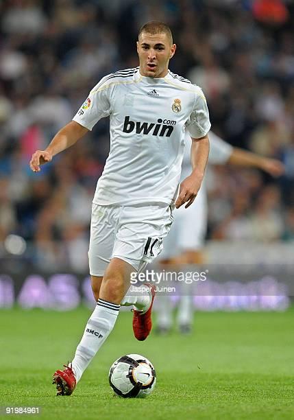 Karim Benzema of Real Madrid runs with the ball during the La Liga match between Real Madrid and Valladolid at Estadio Santiago Bernabeu on October...