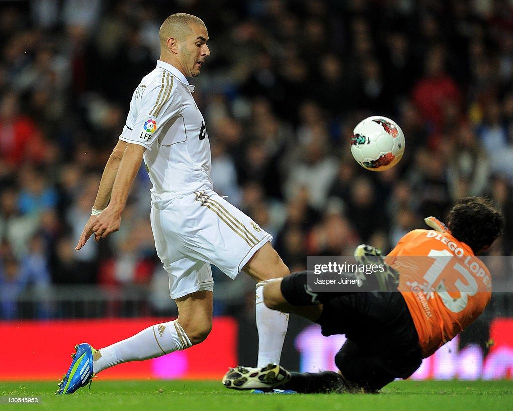 Karim Benzema (L) of Real Madrid scores his sides opening goal past goalkeeper Diego Lopez of Villarreal during the la Liga match between Real Madrid and Villarreal at the Estadio Santiago Bernabeu on October 26, 2011 in Madrid, Spain.