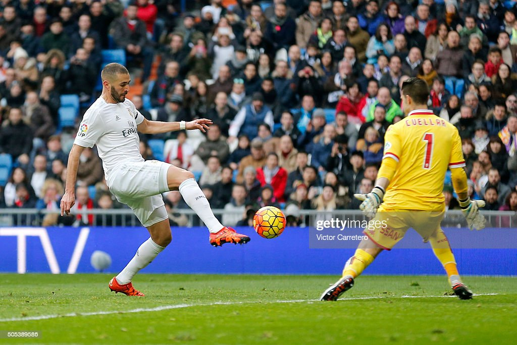 Karim Benzema of Real Madrid scores his team's fifth goal during the La Liga match between Real Madrid CF and Sporting de Gijon at Estadio Santiago Bernabeu on January 17, 2016 in Madrid, Spain.