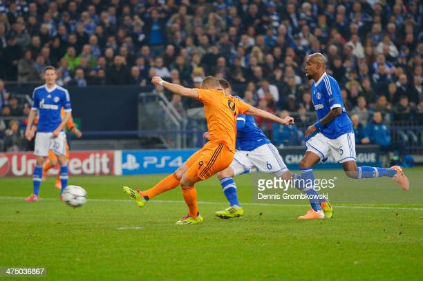 Karim Benzema of Real Madrid scores his team's first goal during the UEFA Champions League Round of 16 first leg match between Schalke 04 and Real...