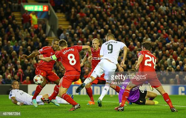 Karim Benzema of Real Madrid scores his team's third goal during the UEFA Champions League Group B match between Liverpool and Real Madrid CF on...