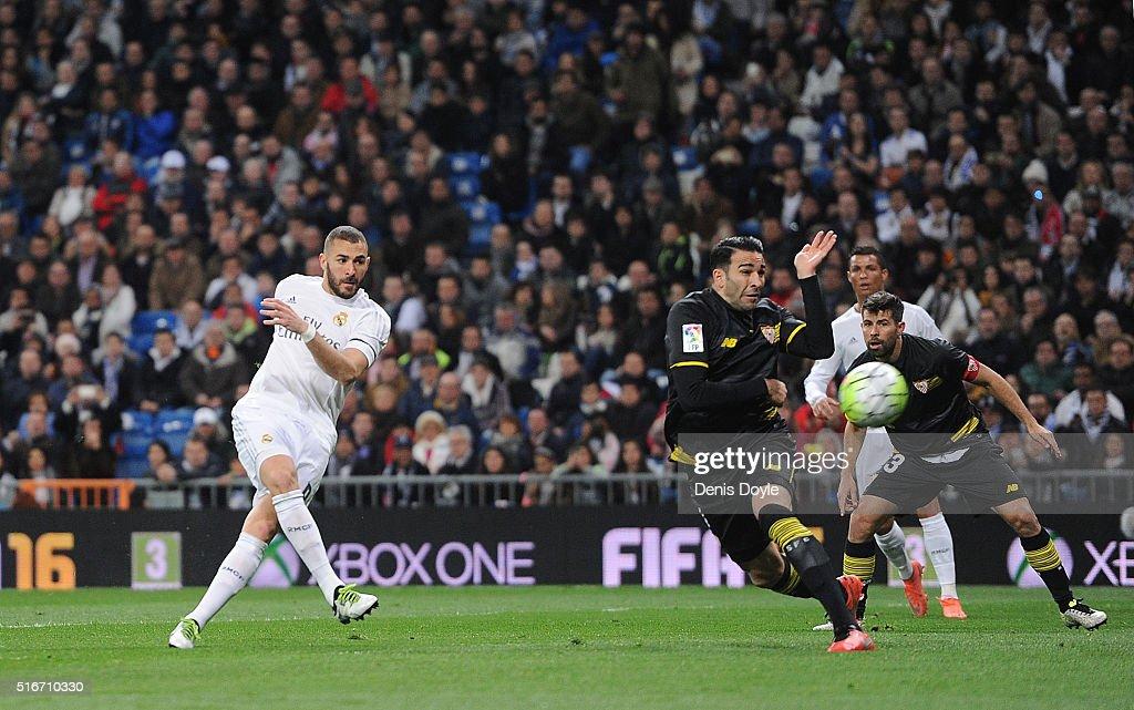 Karim Benzema of Real Madrid scores Real's opening goal during the La Liga match between Real Madrid CF and Sevilla FC at Estadio Santiago Bernabeu...