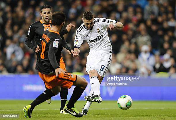 Karim Benzema of Real Madrid scores the opening goal during the Copa del Rey quarterfinal first leg match between Real Madrid and Valencia at Estadio...