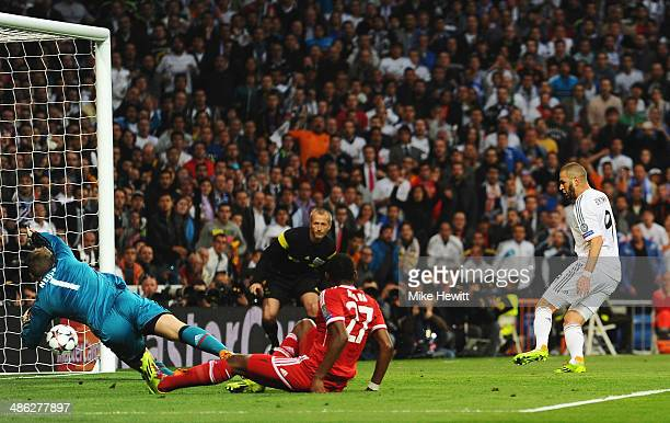 Karim Benzema of Real Madrid scores the opening goal during the UEFA Champions League semifinal first leg match between Real Madrid and FC Bayern...