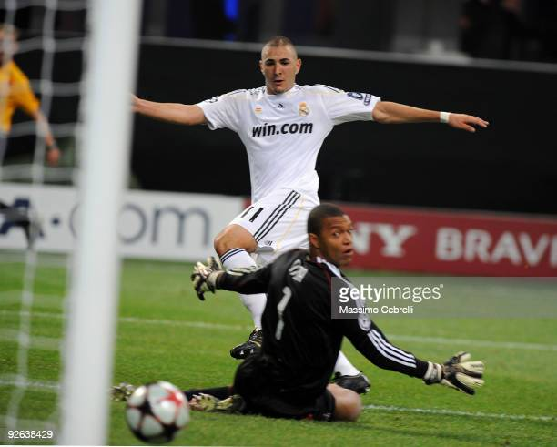 Karim Benzema of Real Madrid scores the opening goal during the UEFA Champions League group C match between AC Milan and Real Madrid at the Stadio...