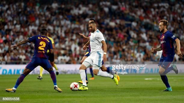 Karim Benzema of Real Madrid Semedo of Barcelona and Rakitic of Barcelona battle for the ball during the Supercopa de Espana Supercopa Final 2nd Leg...