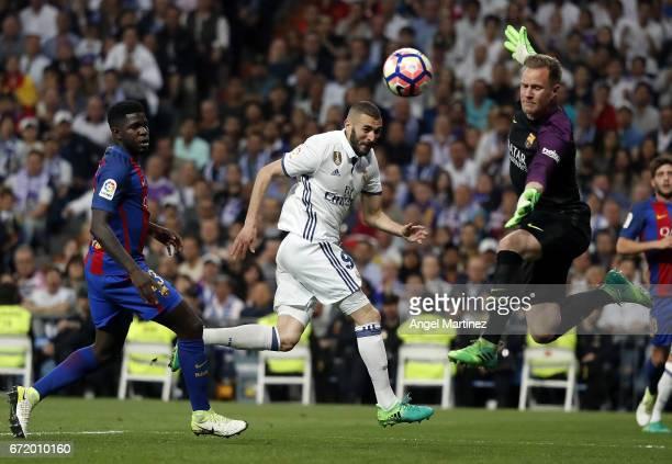 Karim Benzema of Real Madrid shoots on goal past MarcAndre Ter Stegen of FC Barcelona during the La Liga match between Real Madrid and FC Barcelona...