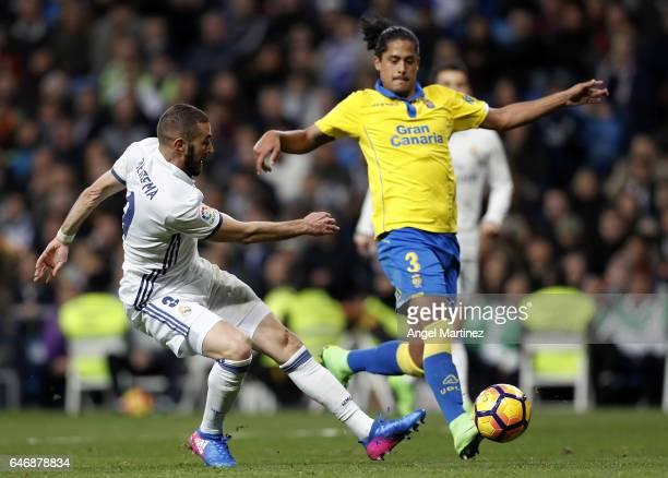 Karim Benzema of Real Madrid shoots on goal past Mauricio Lemos of UD Las Palmas during the La Liga match between Real Madrid and UD Las Palmas at...