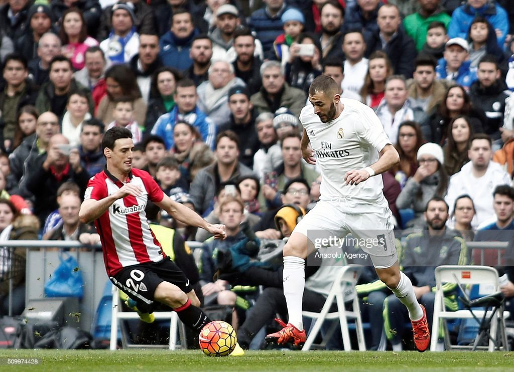 Karim Benzema (R) of Real Madrid vie for the ball against Aritz Aduriz of Athletic Bilbao during La Liga Football match between Real Madrid and Athletic Bilbao at Santiago Bernabeu Stadium in Madrid, Spain on February 13, 2016.