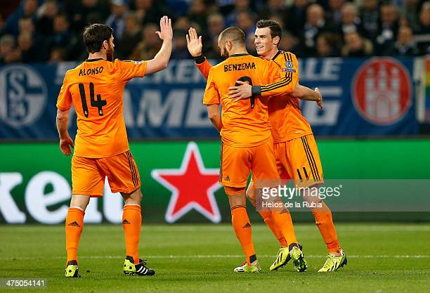 Karim Benzema Xabi Alonso and Gareth Bale of Real Madrid celebrate after scoring during the UEFA Champions League Round of 16 first leg match between...