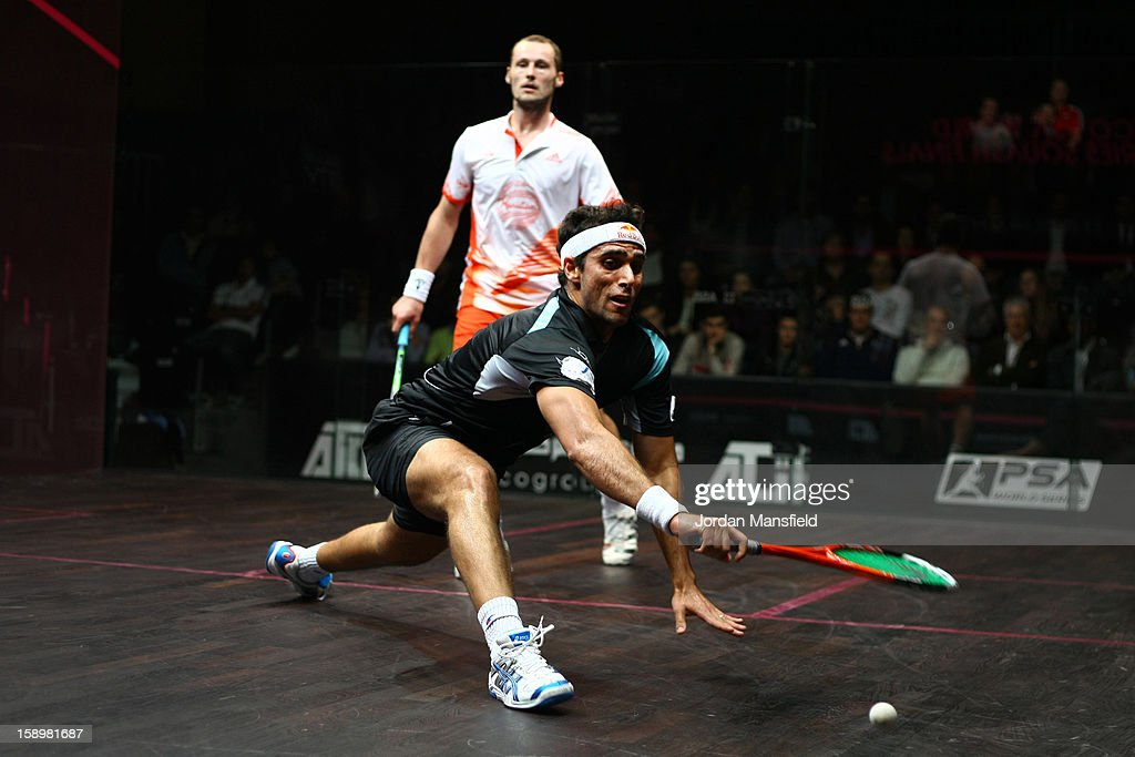 Karim Darwish of Egypt in action against Gregory Gaultier of France during Day 3 of the ATCO World Series Squash Finals played at Queens Club on January 4, 2013 in London, England.