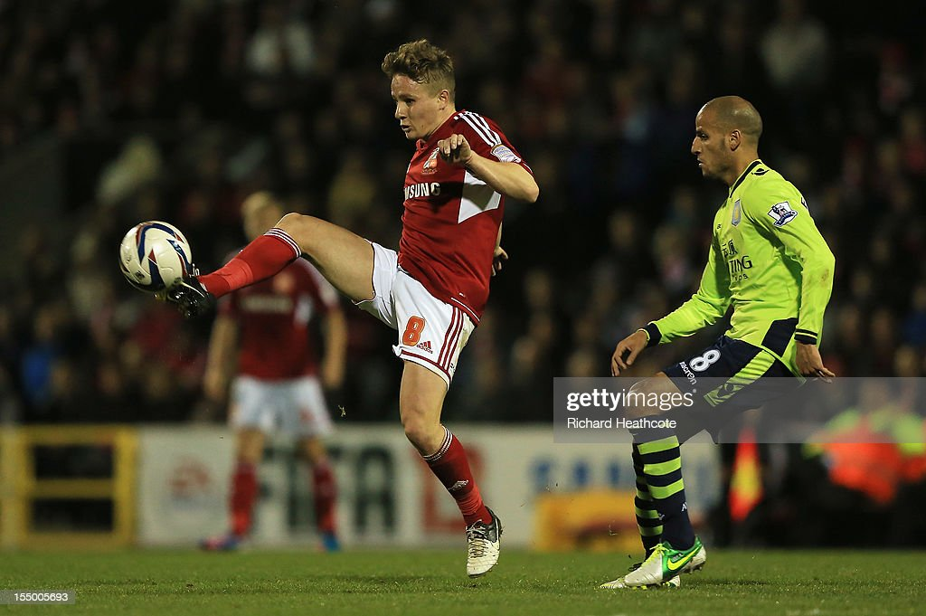 Karim El Ahmadi of Aston Villa closes down Simon Ferry of Swindon Town during the Capital One Cup Fourth Round match between Swindon Town and Aston Villa at the County Ground on October 30, 2012 in Swindon, England.