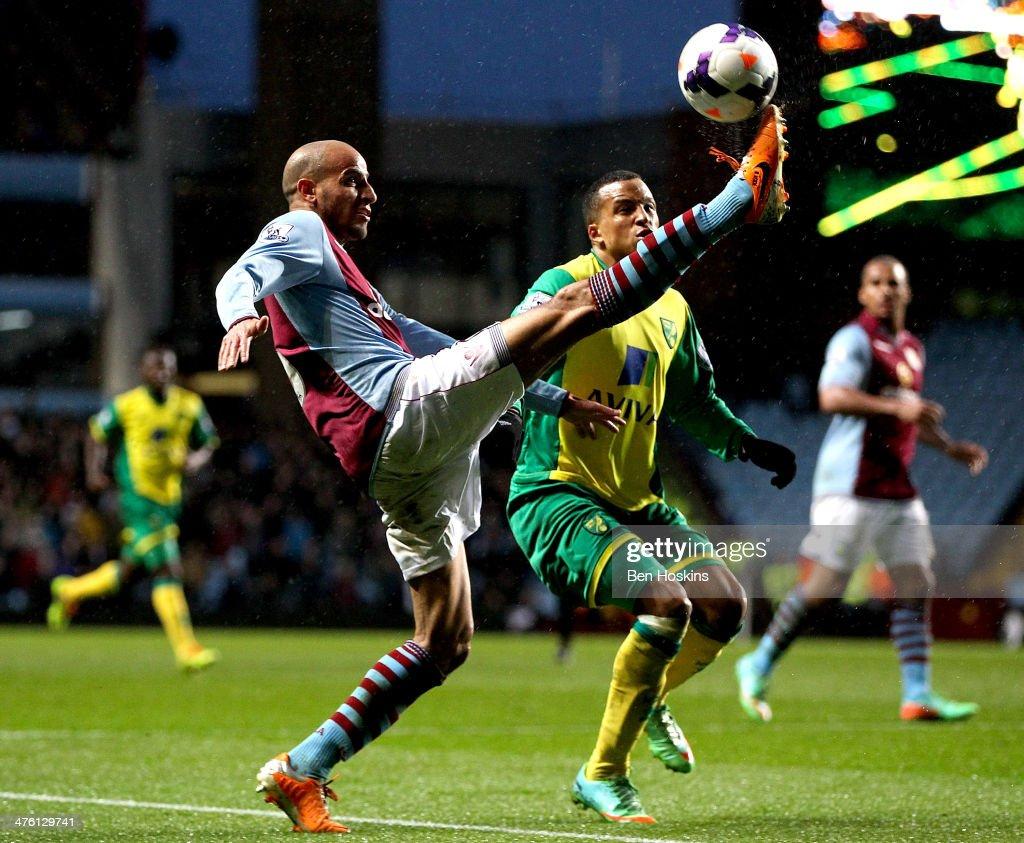 <a gi-track='captionPersonalityLinkClicked' href=/galleries/search?phrase=Karim+El+Ahmadi&family=editorial&specificpeople=2345993 ng-click='$event.stopPropagation()'>Karim El Ahmadi</a> of Aston Villa controls the ball ahead of <a gi-track='captionPersonalityLinkClicked' href=/galleries/search?phrase=Martin+Olsson&family=editorial&specificpeople=4185617 ng-click='$event.stopPropagation()'>Martin Olsson</a> of Norwich during the Barclays Premier League match between Aston Villa and Norwich City at Villa Park on March 2, 2014 in Birmingham, England.