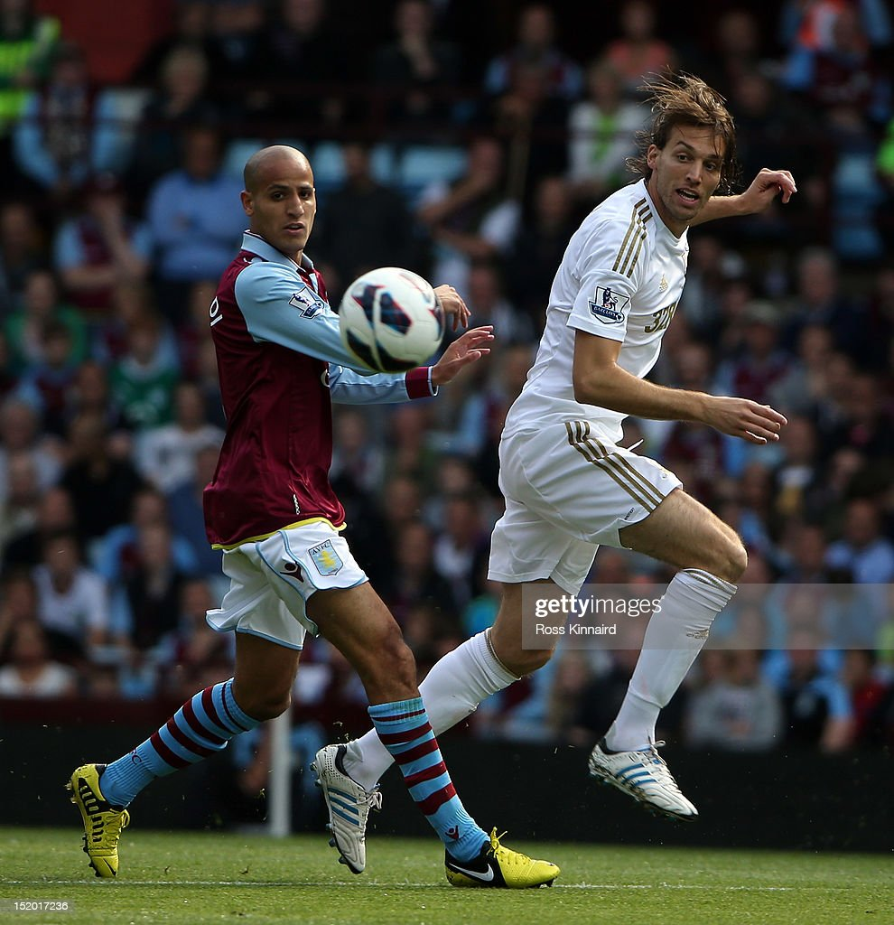 Karim El Ahmadi of Aston Villa is challenged by Miguel <a gi-track='captionPersonalityLinkClicked' href=/galleries/search?phrase=Michu+-+Soccer+Player&family=editorial&specificpeople=9691137 ng-click='$event.stopPropagation()'>Michu</a> of Swansea during the Barclays Premier League match between Aston Villa and Swansea City at Villa Park on September 15, 2012 in Birmingham, England.