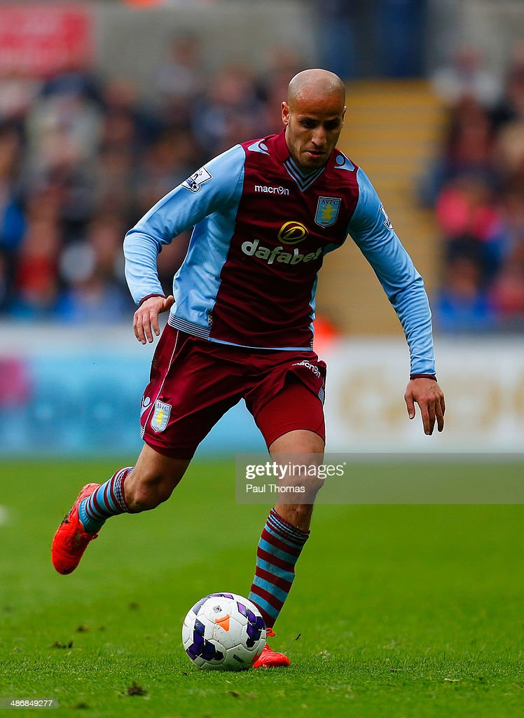 <a gi-track='captionPersonalityLinkClicked' href=/galleries/search?phrase=Karim+El+Ahmadi&family=editorial&specificpeople=2345993 ng-click='$event.stopPropagation()'>Karim El Ahmadi</a> of Aston Villa on the ball during the Barclays Premier League match between Swansea City and Aston Villa at Liberty Stadium on April 26, 2014 in Swansea, Wales.