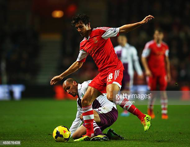 Karim El Ahmadi of Aston Villa tackles Jack Cork of Southampton during the Barclays Premier League match between Southampton and Aston Villa at St...