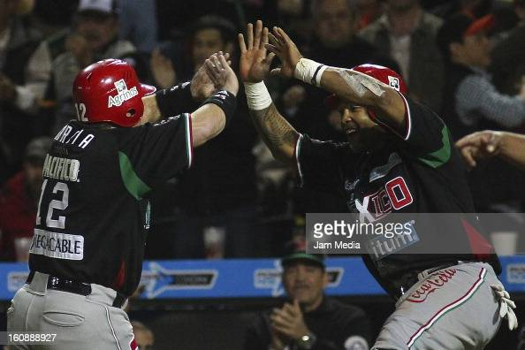 Karim Garcia and Marlon Byrd of Mexico celebrates during a match between Mexico and Puerto Rico for the Caribbean Series 2013 on February 6 2013 in...