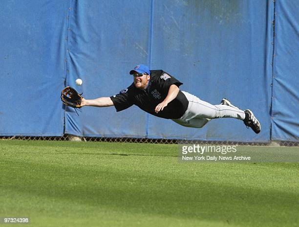 Karim Garcia flies through the air with the greatest of ease in pursuit of a fly ball at the New York Mets' spring training camp in Port St Lucie Fla