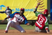 Karim Garcia of Mexican Yaquis de Obregon is out in second base by shortstop of Irving Falu of Puerto Rican Indios de Mayaguez during the fifth...