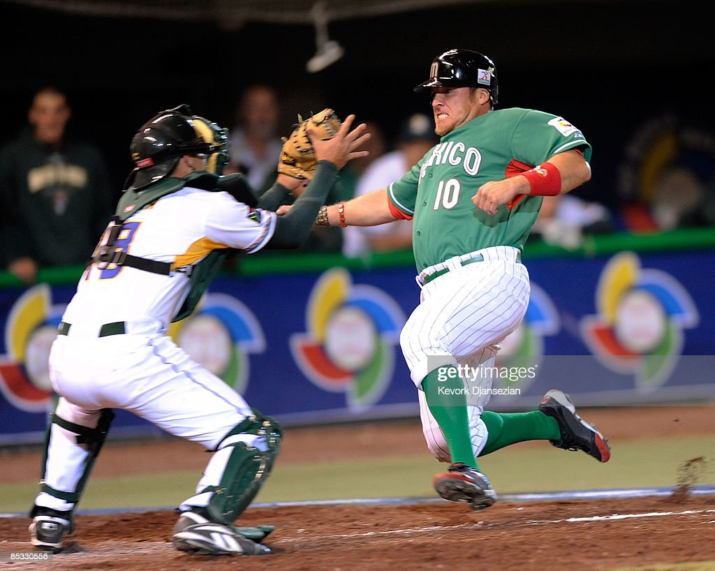 Karim Garcia # 10 of Mexico is tagged out at home plate by Kyle Botha #18 of South Africa during the eighth inning of the 2009 World Baseball Classic Pool B match on March 9, 2009 at the Estadio Foro Sol in Mexico City, Mexico.